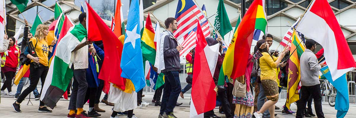 Image of International Students Carrying Flags